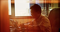NCAB Group employee working at a computer