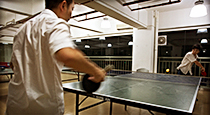 Factory employees playing ping-pong