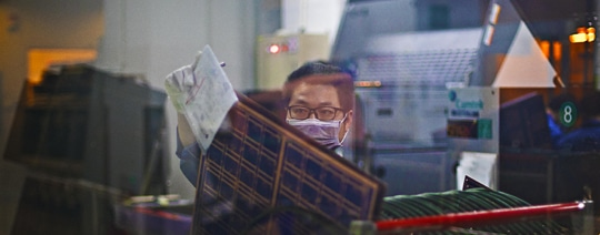 NCAB Group employee working in a PCB factory | NCAB Group